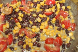 Mix your cooked quinoa, black beans, corn, tomatoes, onion salt, olive oil and  dressing.