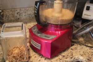 Pulse your walnuts in your food processor.