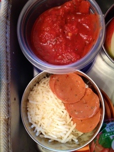 Mozzarella, Vegan pepperoni, and sauce to build mini-pizzas on those cute little pitas.