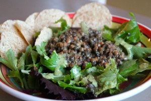 Place lentils on your mixed greens, drizzle with a bit more dressing. Add your chips.