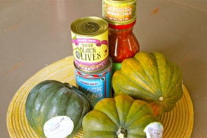 Start with your stuff. A few basic ingredients. Acorn squash, black beans, green chilis, black olives, and salsa.