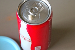 Seems innocent enough. A cute little can of Coke and a cute little clean tooth.