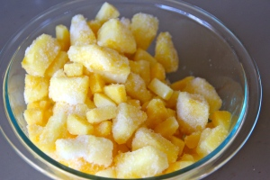 Take some frozen pineapple chunks.