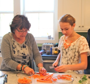 Older kids were assigned the more difficult cutting, like carrots, while the younger ones did the leafy greens.