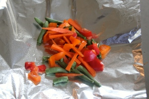 Add your veggies to one of your foil pieces.