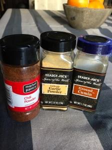 Chili powder, garlic powder, and cumin.