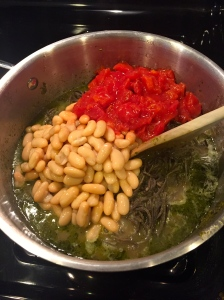 Add your diced tomatoes and (gasp) more beans....